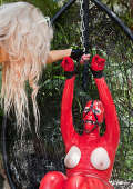 Latex slavegirl masked and chained outdoors