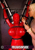 Bound busty slavegirl in red latex and mask