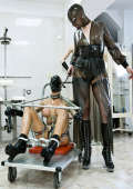 Restrained slavegirl with transparent mask