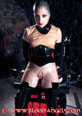 Rubber fetish doll in the dungeon