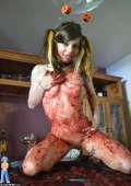 Cute teen Halloween caking mess