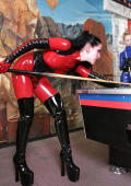 Kinky latex girls play poolbilliard.