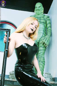 Spooky young blond in black rubber dress