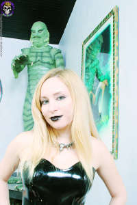 Spooky young blond with black lips