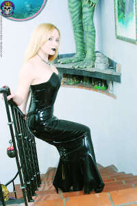 Spooky kinky young blond in rubber dress