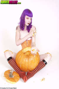Purple haired Haloween teen with pumkin