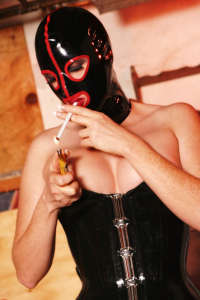 Hooded hottie Petra smoking in black and red rubber