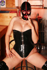 Hooded hottie Petra smoking
