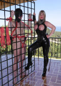 Caged slave and busty domme