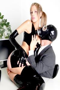RUBBER SLUT Angela pleasuring the boss