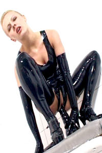 Dirty rubber bitch Nikita with black dildo