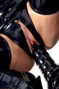 Dirty rubber bitch Nikita with big black dildo close up