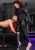 Red haired Dominatrix and slave