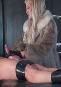 Furcoat Domme plays with slaves dick