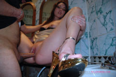 Toilet bitch Laura gets her pussy stuffed